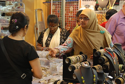 """""""No, no. Five is not enough. It must cover the whole arm"""", the owner of the shop fixes her headscarf ..."""