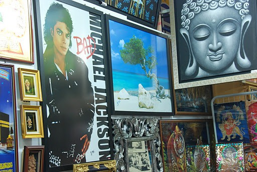 Crammed into the wooden frames, painted prophets raise their hands in a blessing gesture. Among them – a photo of Michael Jackson.