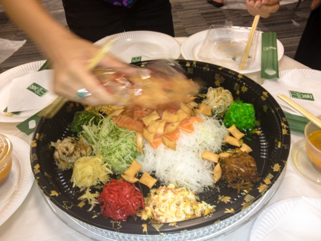 One of the finest moments of the dinner is tossing the Lo Hei salad.