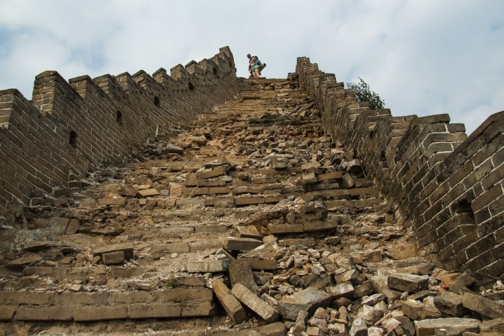 Soon, stairs turn into drifting down patches of loose rocks or almost inaccessible walls, shooting into the sky.