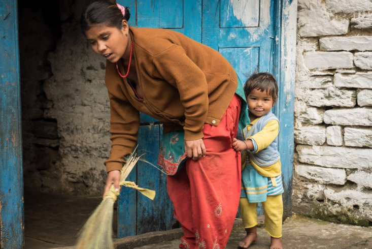 Women sweep thresholds with straw brooms. In the folds of their thick, woollen skirts lurk barefooted sprats.