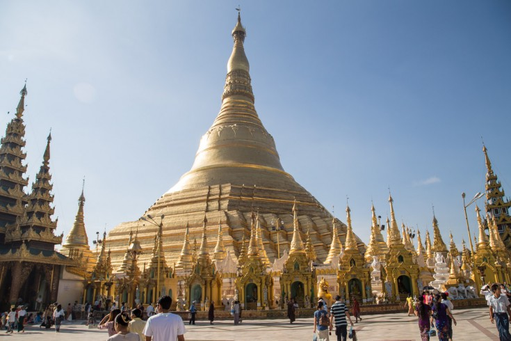 Above them, majestically towers the main stupa – the golden jewel in the crown of the temple complex.