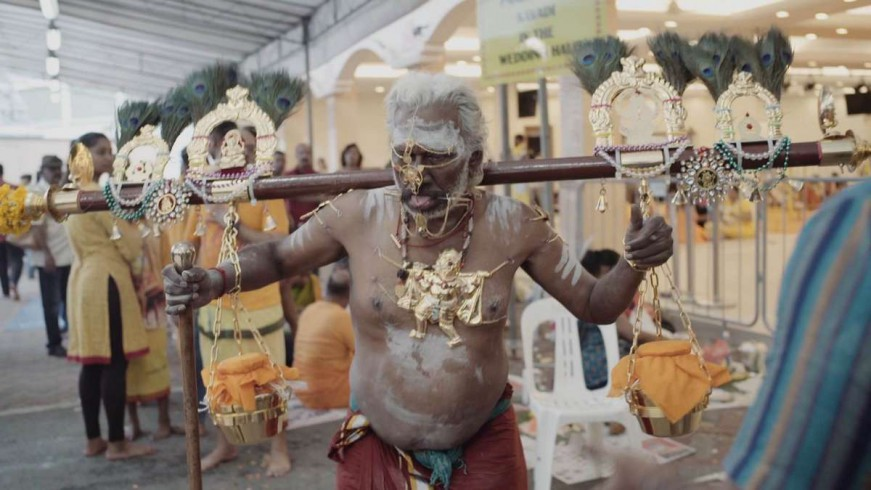 """Some are in the form of a wooden bar with milk pots hanging at both ends - today's equivalent of """"Idumban's Kavadi """", where containers with white liquid have replaced the mountains."""