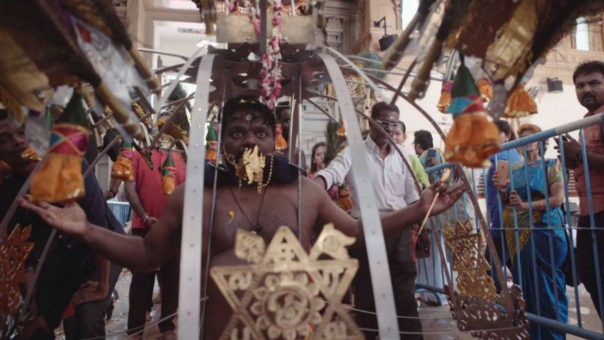 After a while, the man falls on his knees, reaches an altar of god Murugan and loses himself in profound prayer.