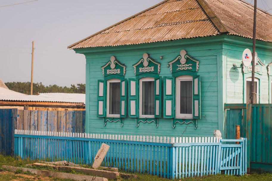 Wooden houses resembling match-like constructions, squat among the lush green hills, or fields and meadows as flat as a table.